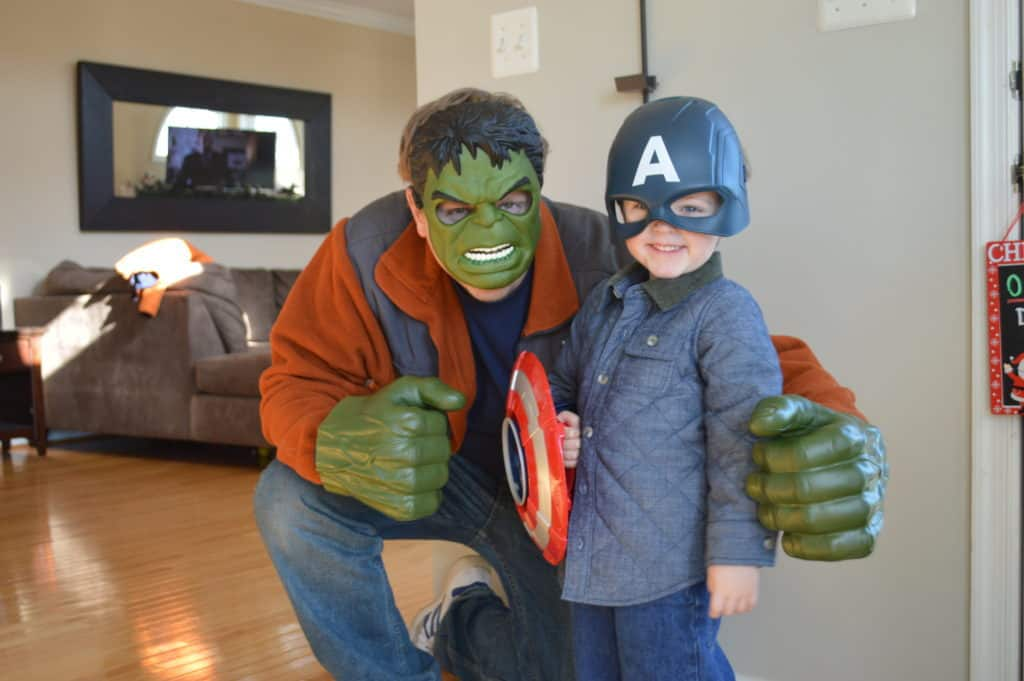 Dad, dressed as Hulk, with his son, dressed as Captain America