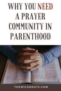 parent's hands praying over Bible