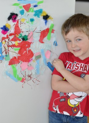 Preschooler poses with his finished Easter egg