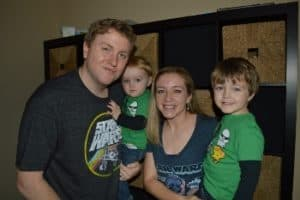 A family of four dressed in Star Wars Shirts