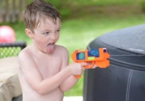 Squirt gun summer activity for preschoolers and toddlers