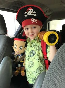 young kid dressed as pirate toy as part of a non toy gift idea of a 529 donation