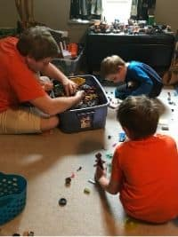 Dad joining the Lego challenge for kids