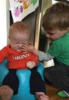 toddler slapping his new baby brother