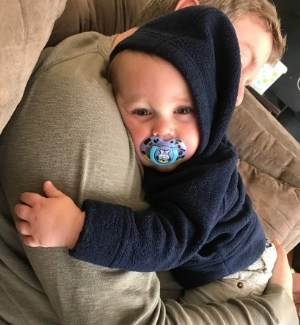 difficult fussy baby being held so he'll stop crying