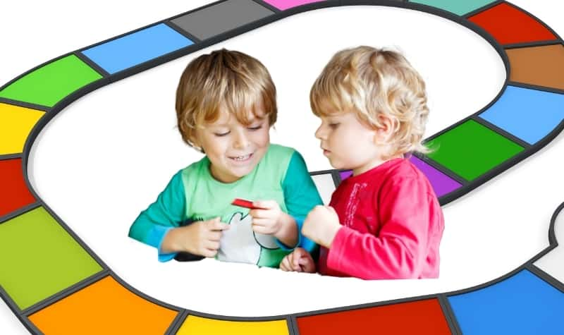 two three year olds playing a board game