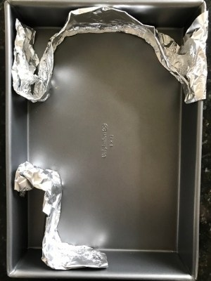 The aluminum pan with the aluminum foil set up in the shape of your Among Us Character