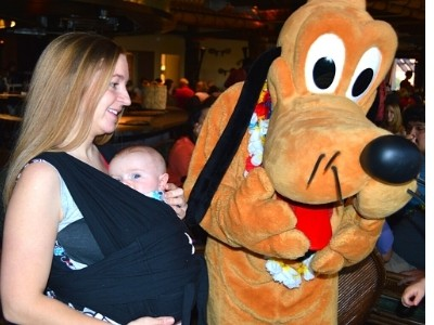 mom and 1 month old baby with Pluto at Disney