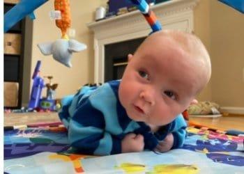 a baby enjoying tummy time