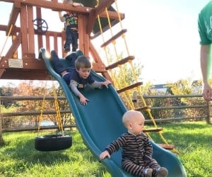 baby and toddler doing outdoor playground daily activities